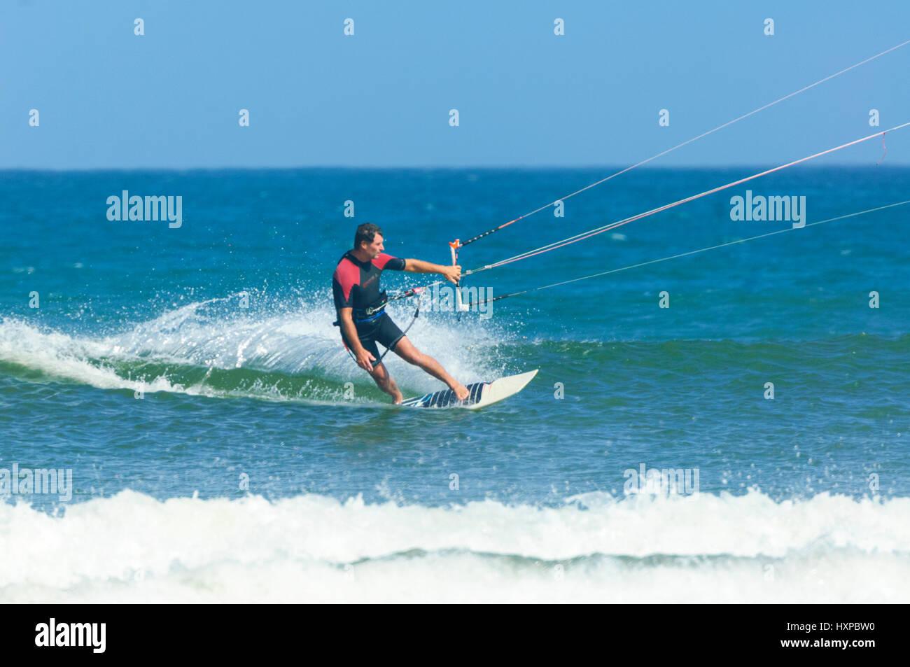 Kite surfer surfing at Seven Mile Beach, Gerroa, Illawarra Coast, New South Wales, NSW, Australia - Stock Image