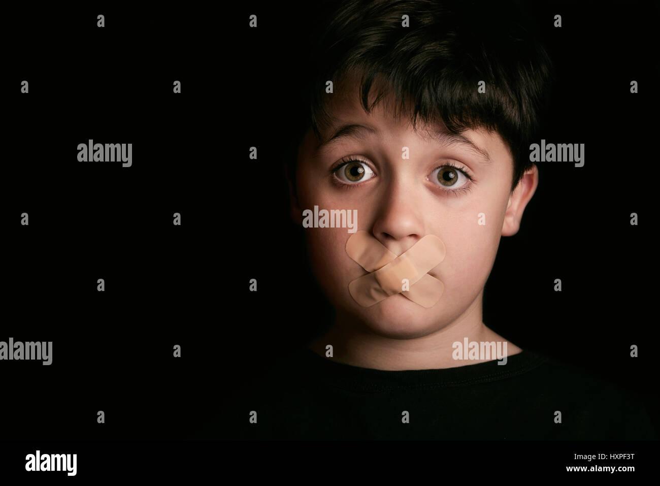 Sad child with Sealed Mouth - Stock Image