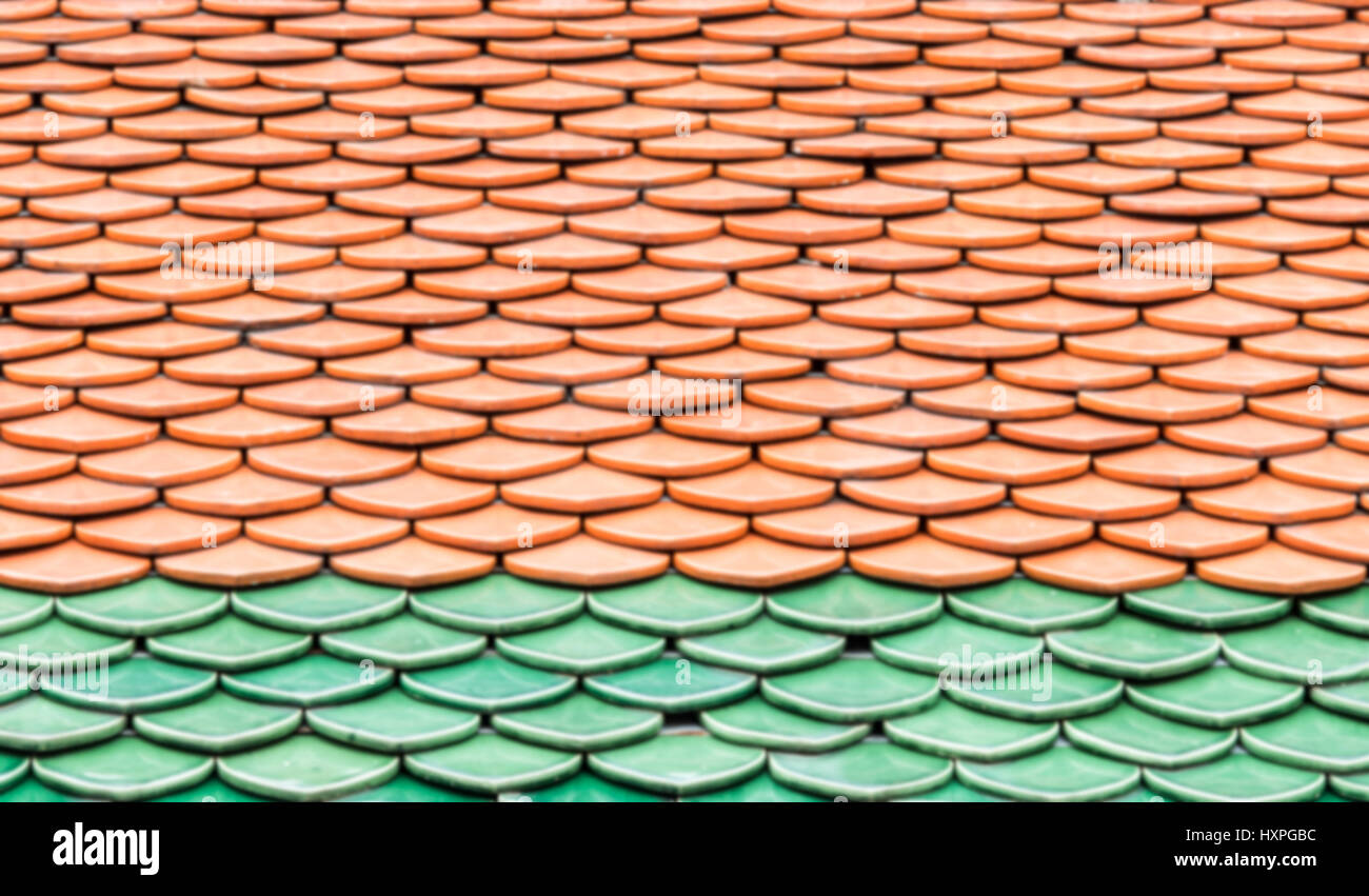 Ceramic tiles roof with the layer pattern of the Thai church.(Blur ...
