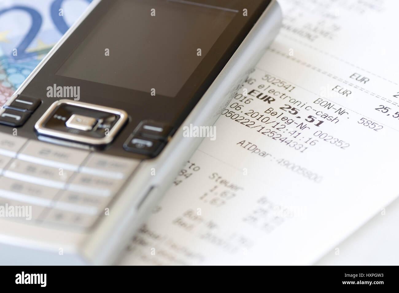 Mobile phone and receipt (no Pr), Handy und Kassenbon (no pr) Stock Photo