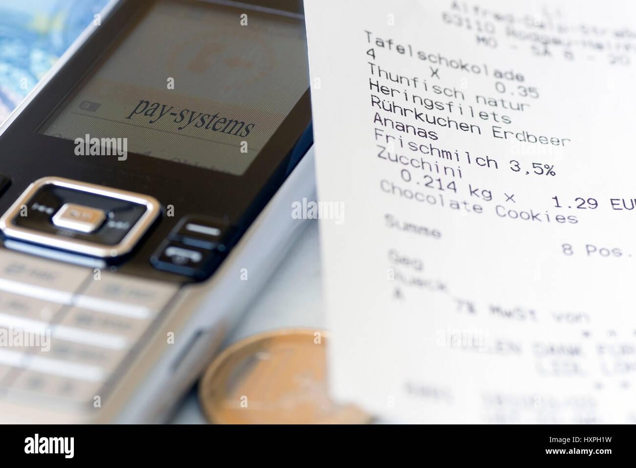 Mobile phone with receipt (no Pr), Handy mit Kassenbon (no pr) Stock Photo