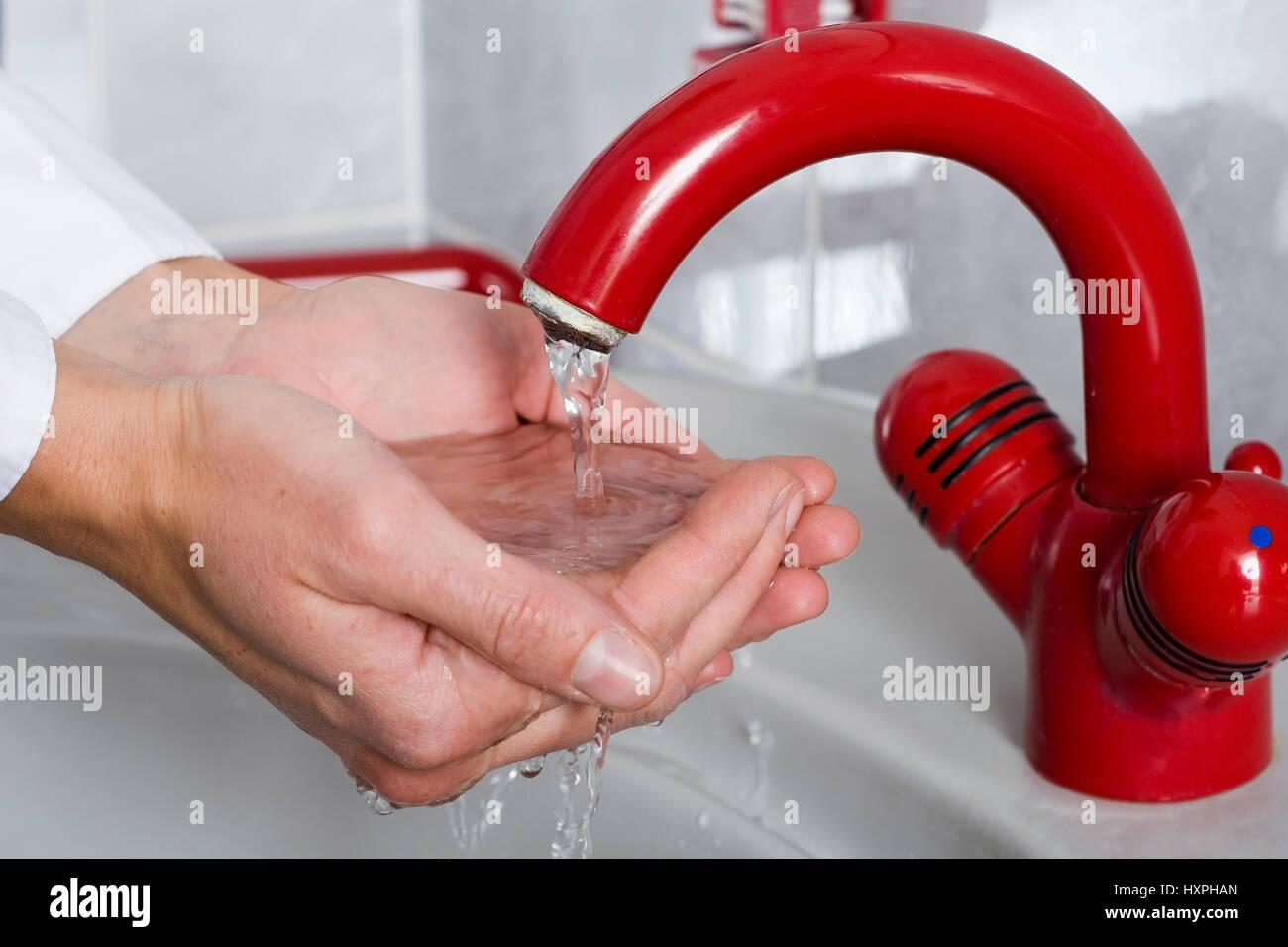 Woman washes the hands (mr) to herself, Frau wäscht sich die Hände (mr) - Stock Image