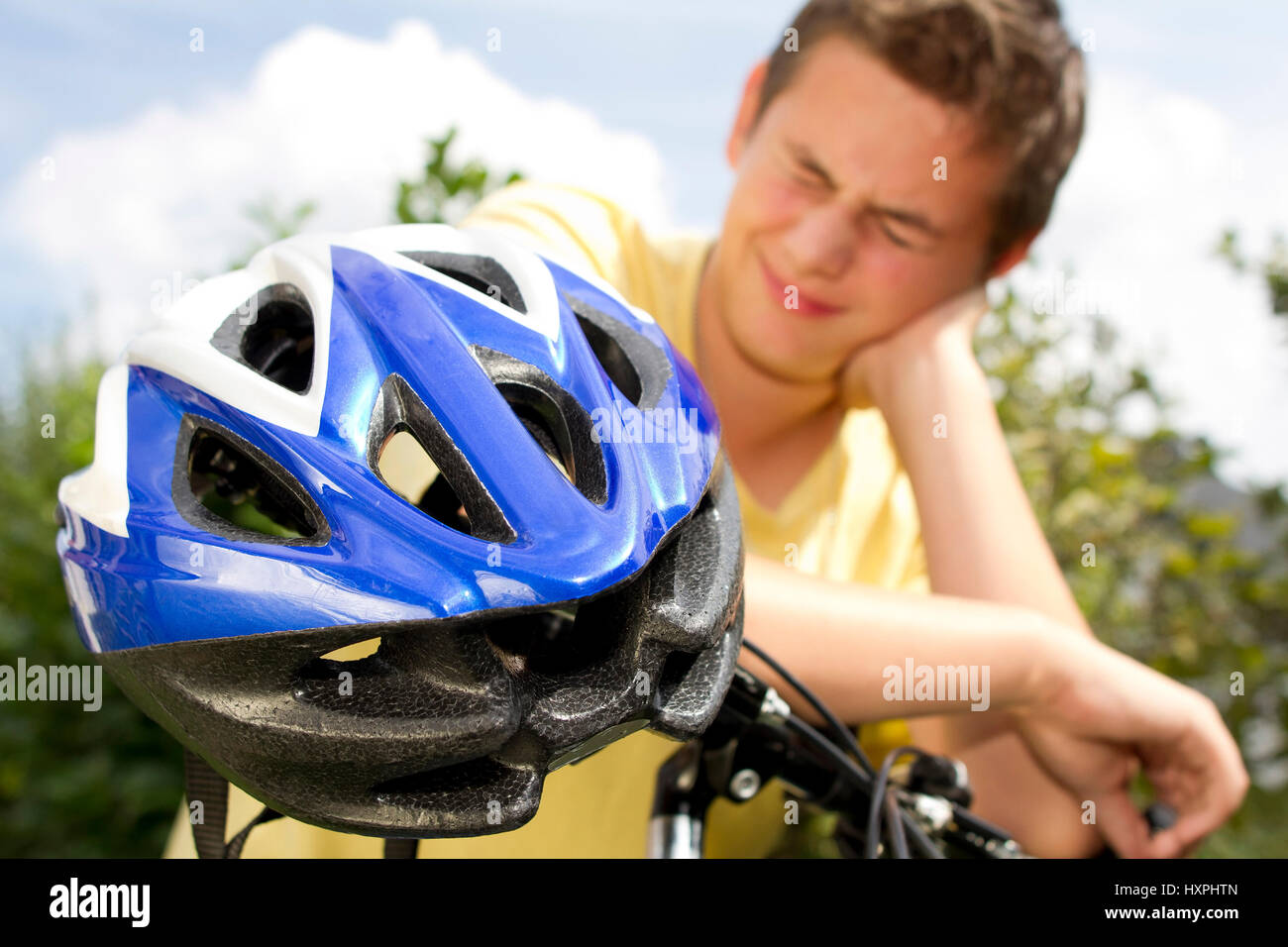 Teenager against bicycle helmet, Teenager gegen Fahrradhelm Stock Photo
