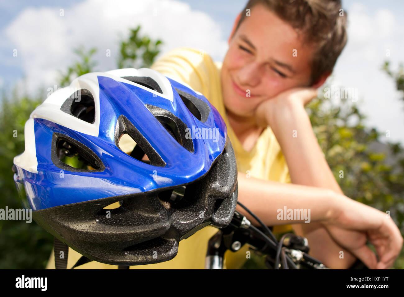 Teenager against bicycle helmet, Teenager gegen Fahrradhelm Stock Photo