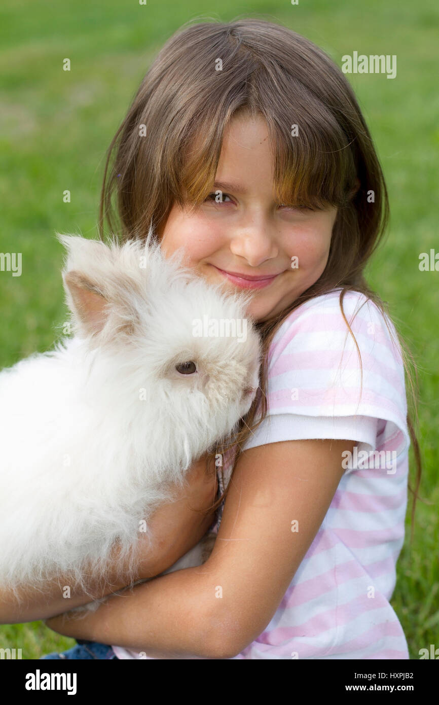 seven-year-old girl with Teddy's dwarf, siebenjähriges Mädchen mit Teddyzwerg Stock Photo