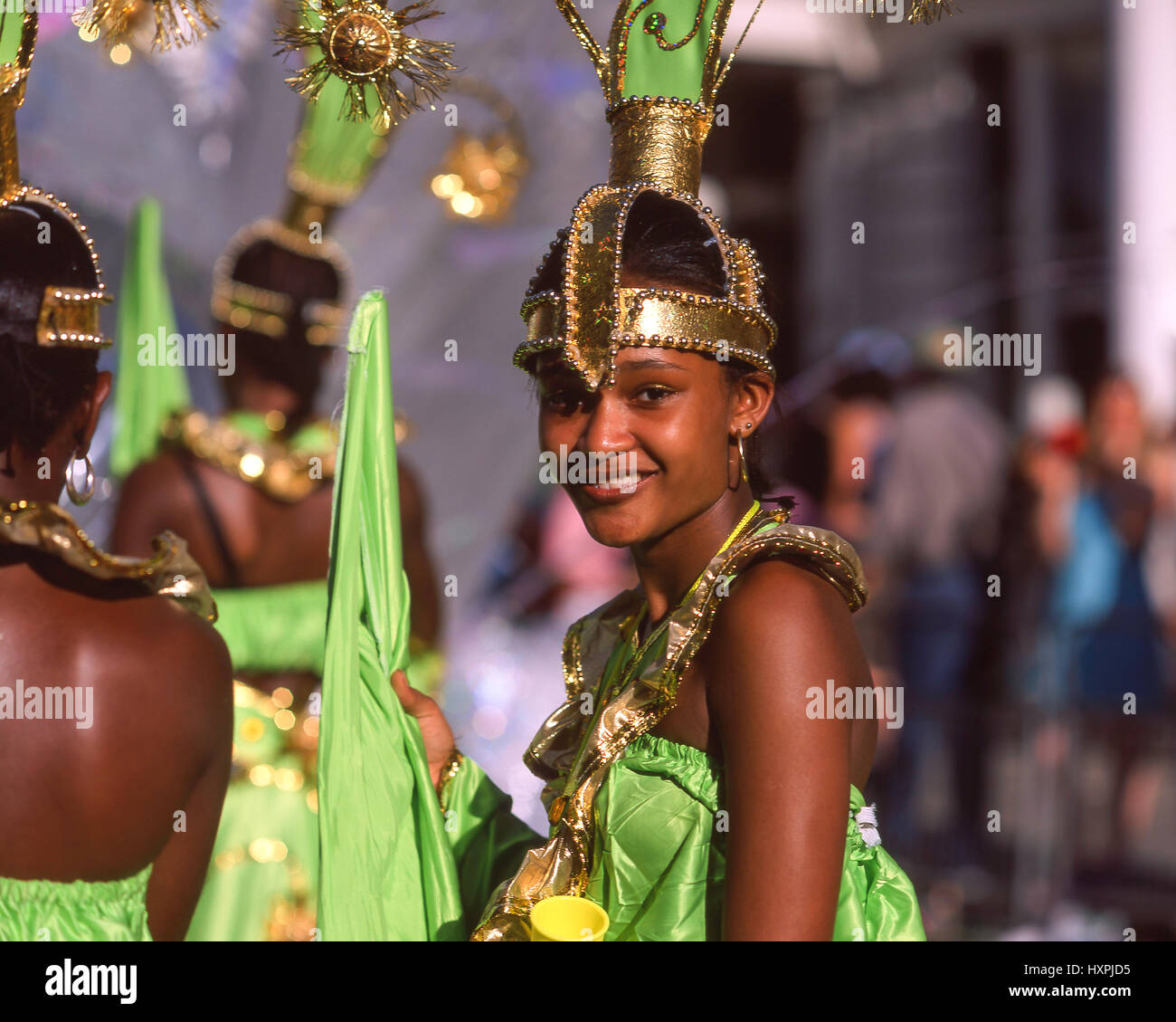 Smiling woman in costume at Notting Hill Carnival, Notting Hill, Royal Borough of Kensington and Chelsea, Greater - Stock Image
