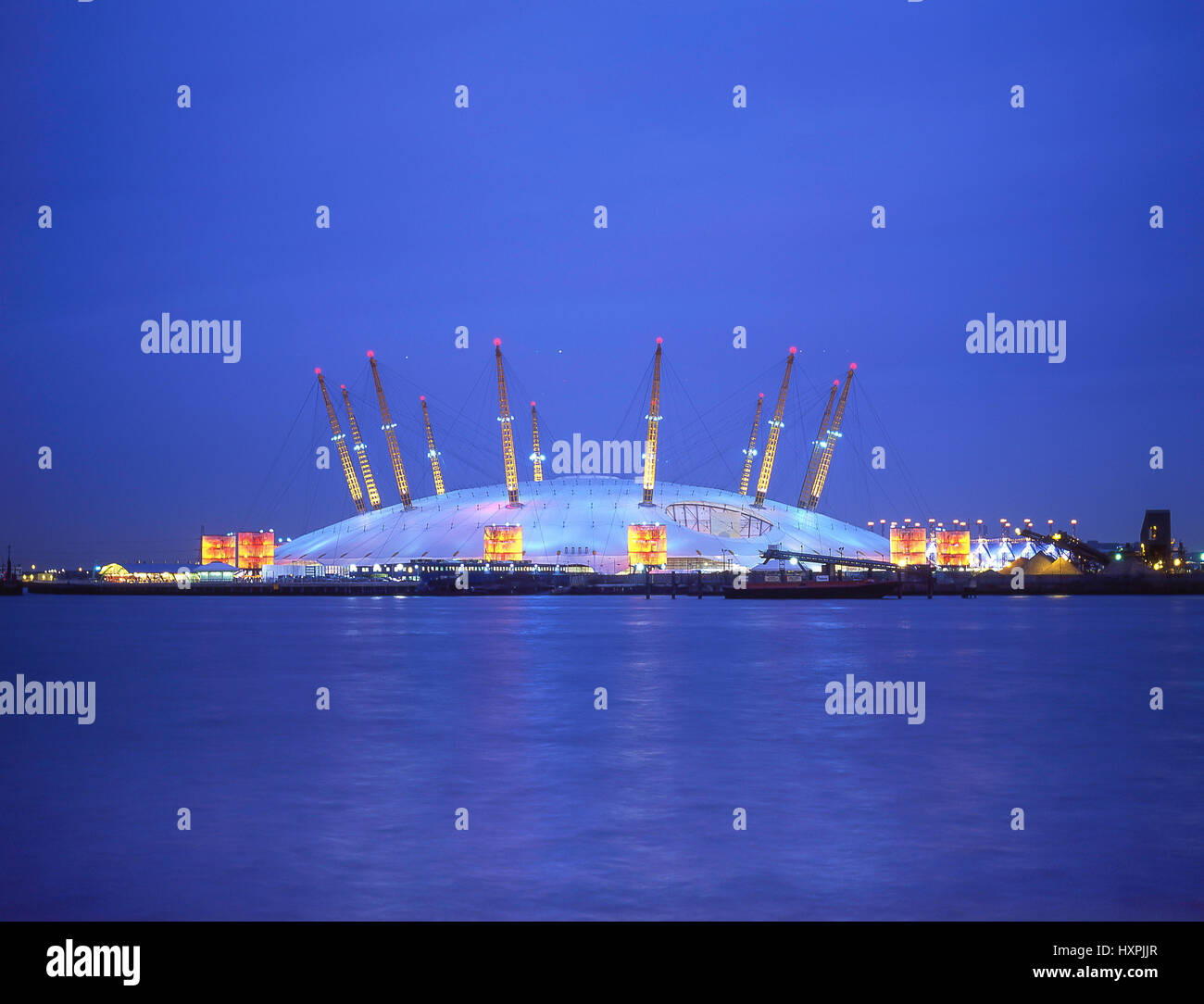 The O2 Arena across River Thames at dusk, Royal Borough of Greenwich, Greater London, England, United Kingdom - Stock Image