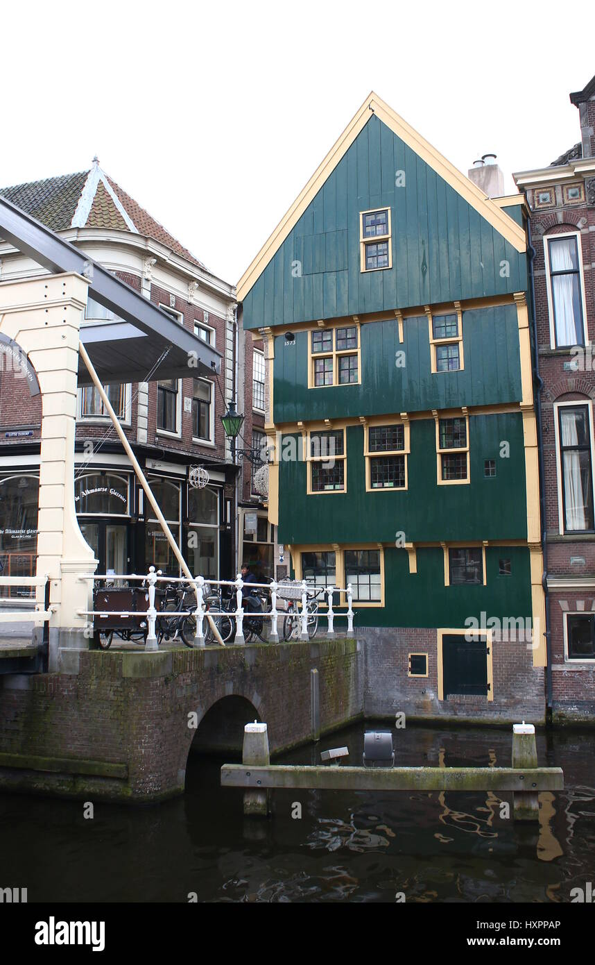 Monumental 16th century green wooden 'Huis met de Kogel' (House with the cannon ball) in central Alkmaar, - Stock Image