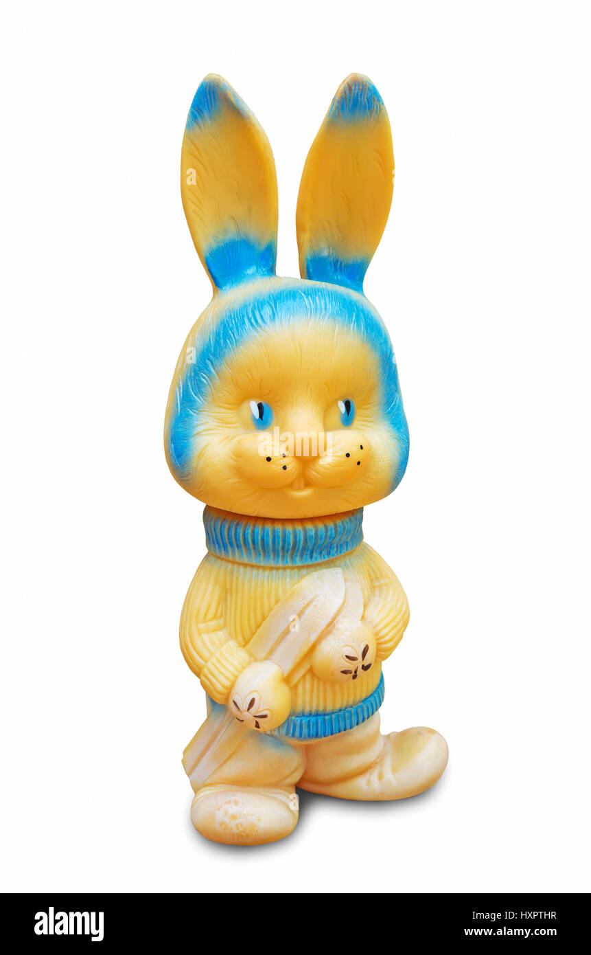 Rubber rabbit toy yellow and blue color for young children - Stock Image