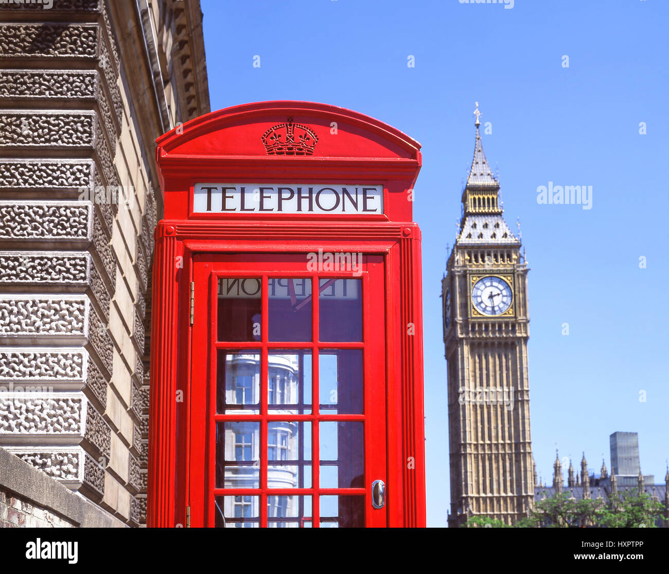 Red telephone kiosk and Big Ben, Parliament Square, City of Westminster, Greater London, England, United Kingdom - Stock Image