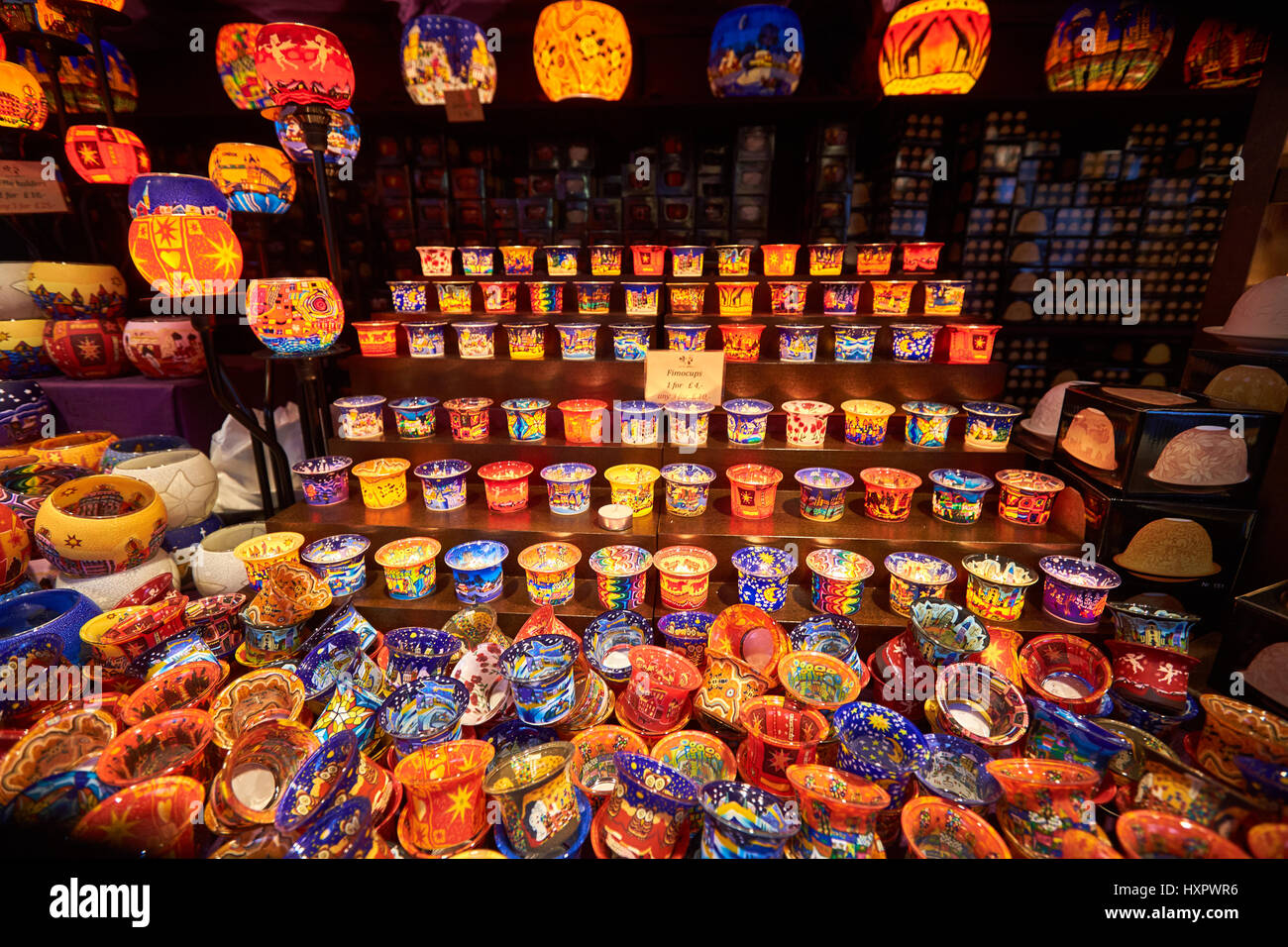 A stall selling candle holders and lanterns at a Christmas market in Leicester Square, London - Stock Image