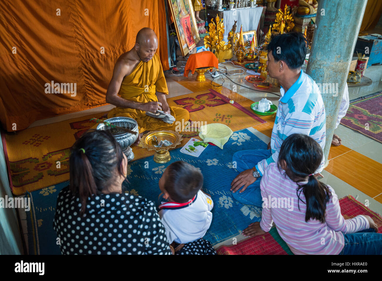 Local people and monk in the Wat Phnom Sampeau temple near Battambang, Cambodia, Asia. - Stock Image