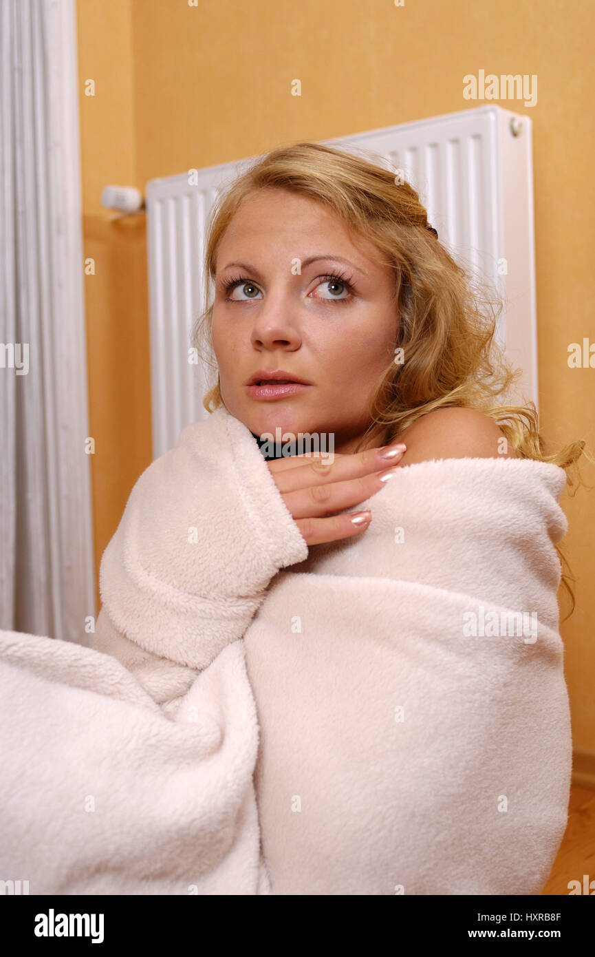 Woman, women, freezes, freezing, heating, heaters, heat, costs, prices, price, risen, high, expensive, expensive, - Stock Image
