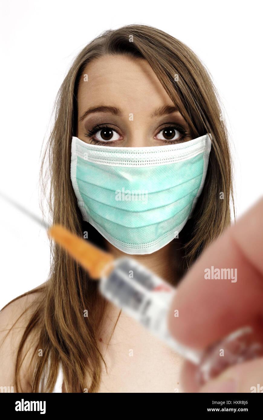 Woman with mask, vaccination against the pork influenza, Frau mit Mundschutz, Impfung gegen die Schweinegrippe Stock Photo