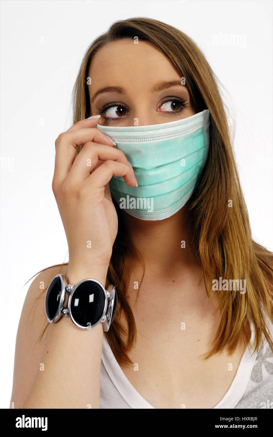 Woman with mask, pork influenza, Frau mit Mundschutz, Schweinegrippe Stock Photo