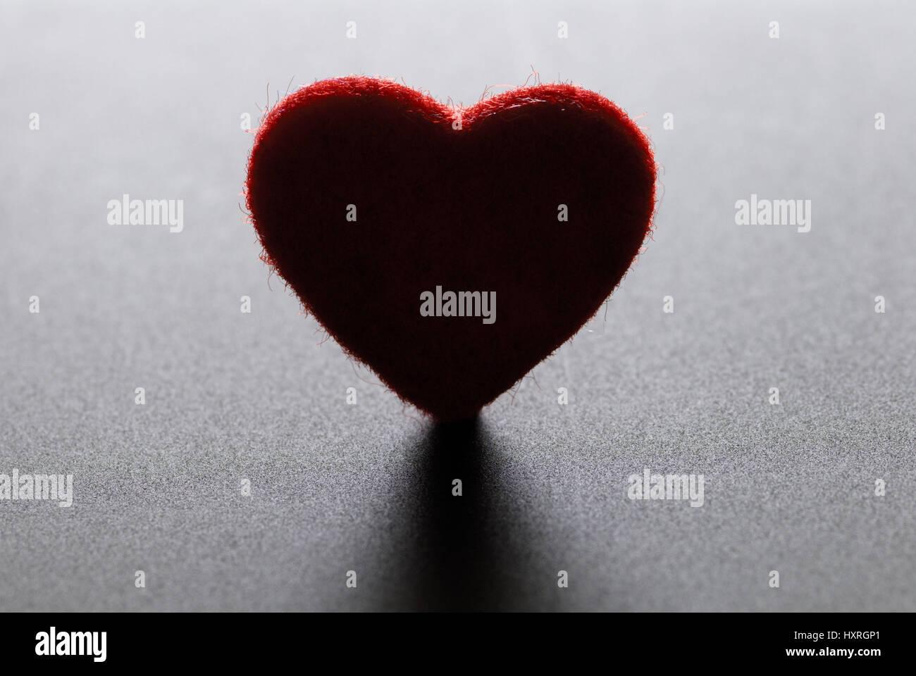 Dark heart, lovesickness, melancholy, love, dear pain, heart-shaped, darkly, shades, red, red, miniature, separation, - Stock Image