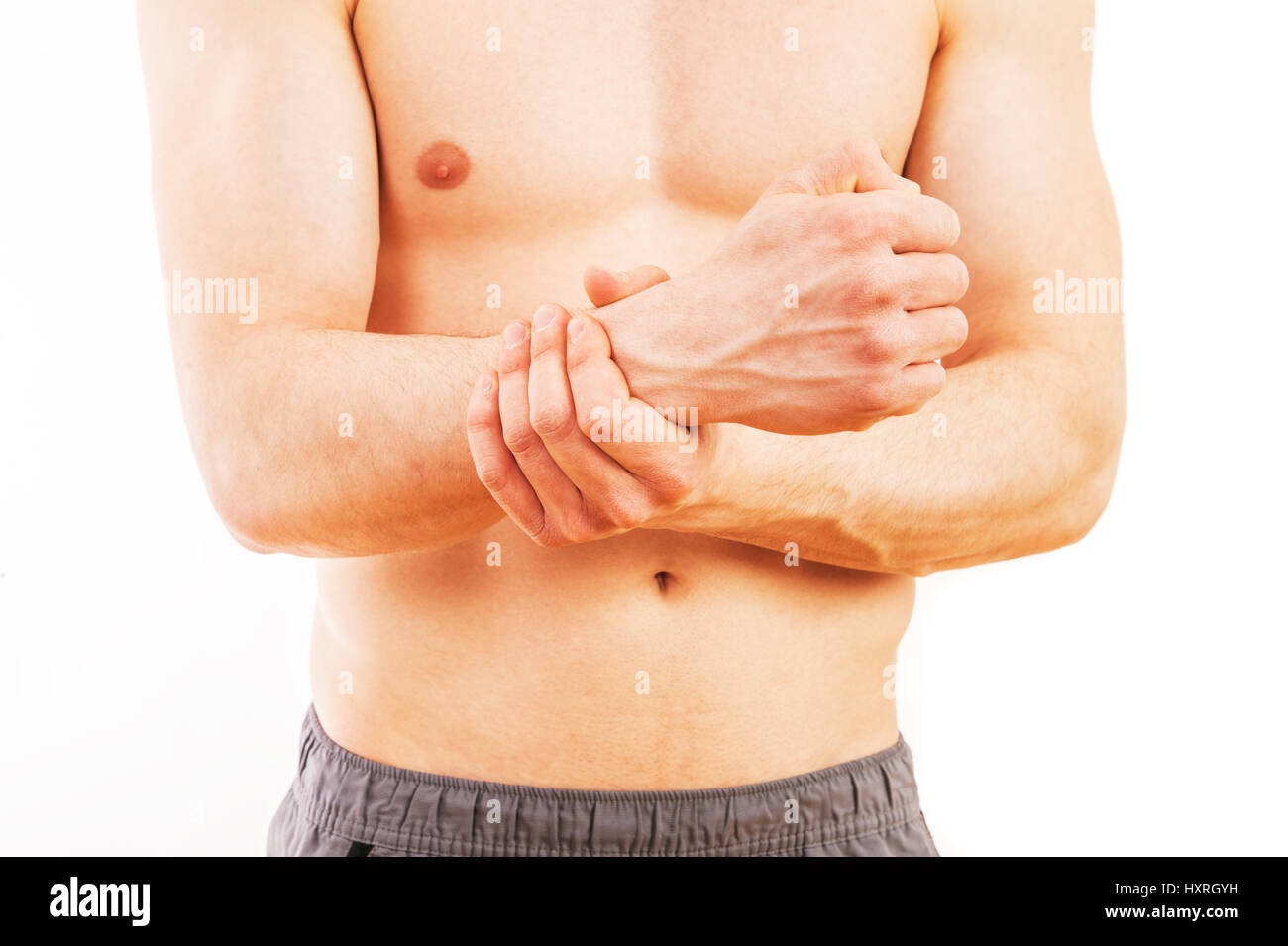 Man with wrist pain over white background - Stock Image