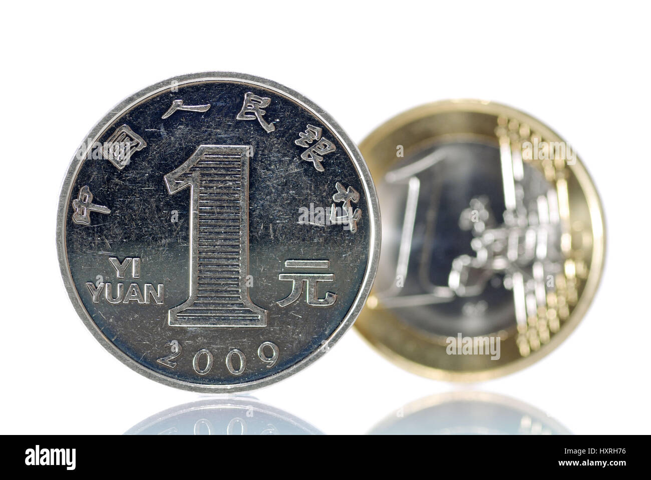 One-yuan coin (Chinese currency) before an euro-coin one, economic development in China and Europe, Ein-Yuan-Münze - Stock Image