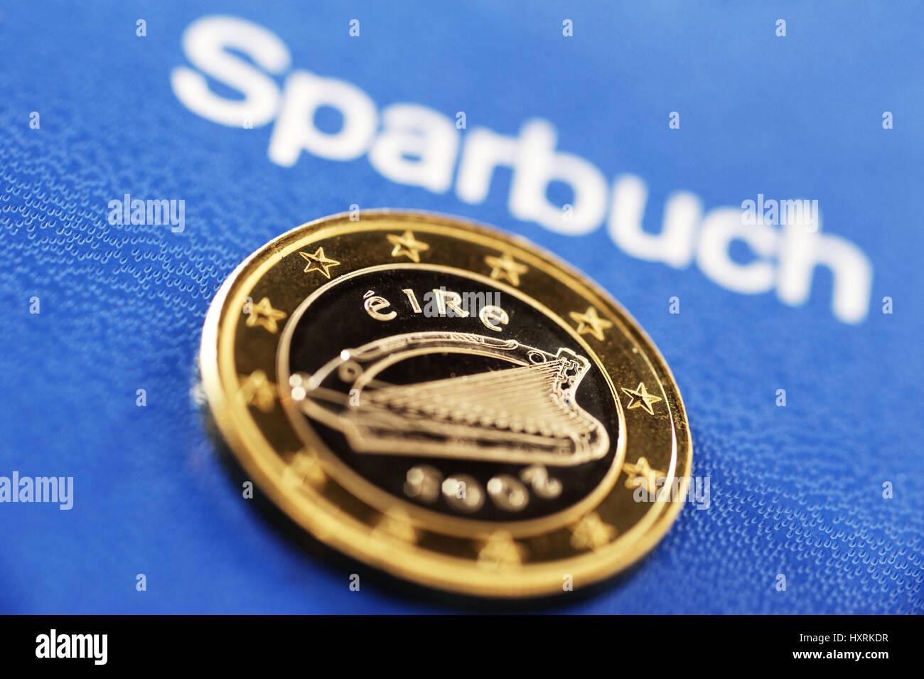 Irish euro-coin one and savings book, state crisis Ireland, Irische Ein-Euro-Münze und Sparbuch, Staatskrise Irland Stock Photo