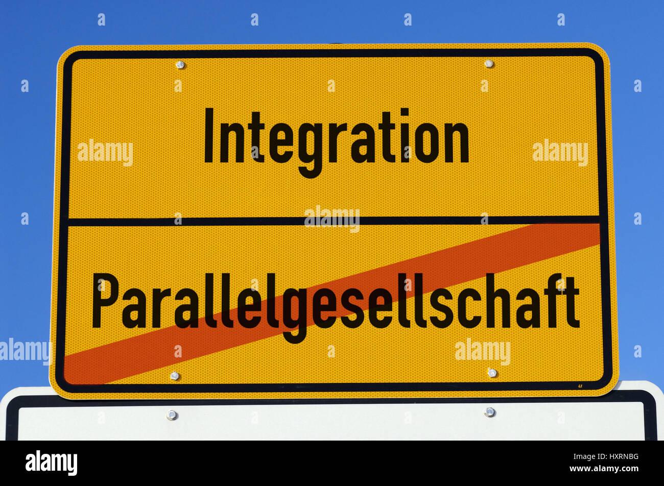 Local sign with label Integration and Parallel society, Ortsschild mit Aufschrift Integration und Parallelgesellschaft - Stock Image