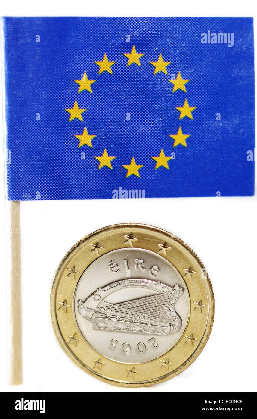 Irish euro-coin one and EU flag, state crisis Ireland, Irische Ein-Euro-Münze und EU-Fahne, Staatskrise Irland Stock Photo