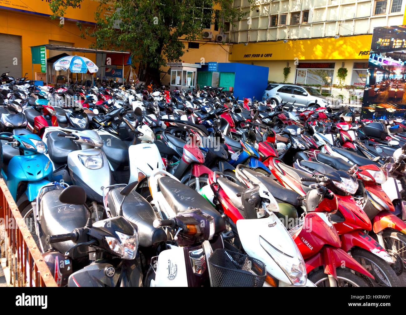Motor bikes tightly packed at car park in Hanoi 2. Vietnam has 38 million registered motorbikes - Stock Image