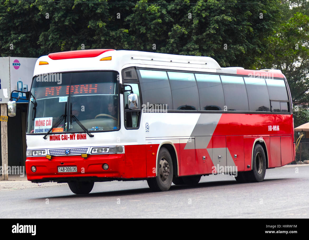 Public buses travel at high speed with little regard for road rules stopping frquently to pick up passengers on - Stock Image