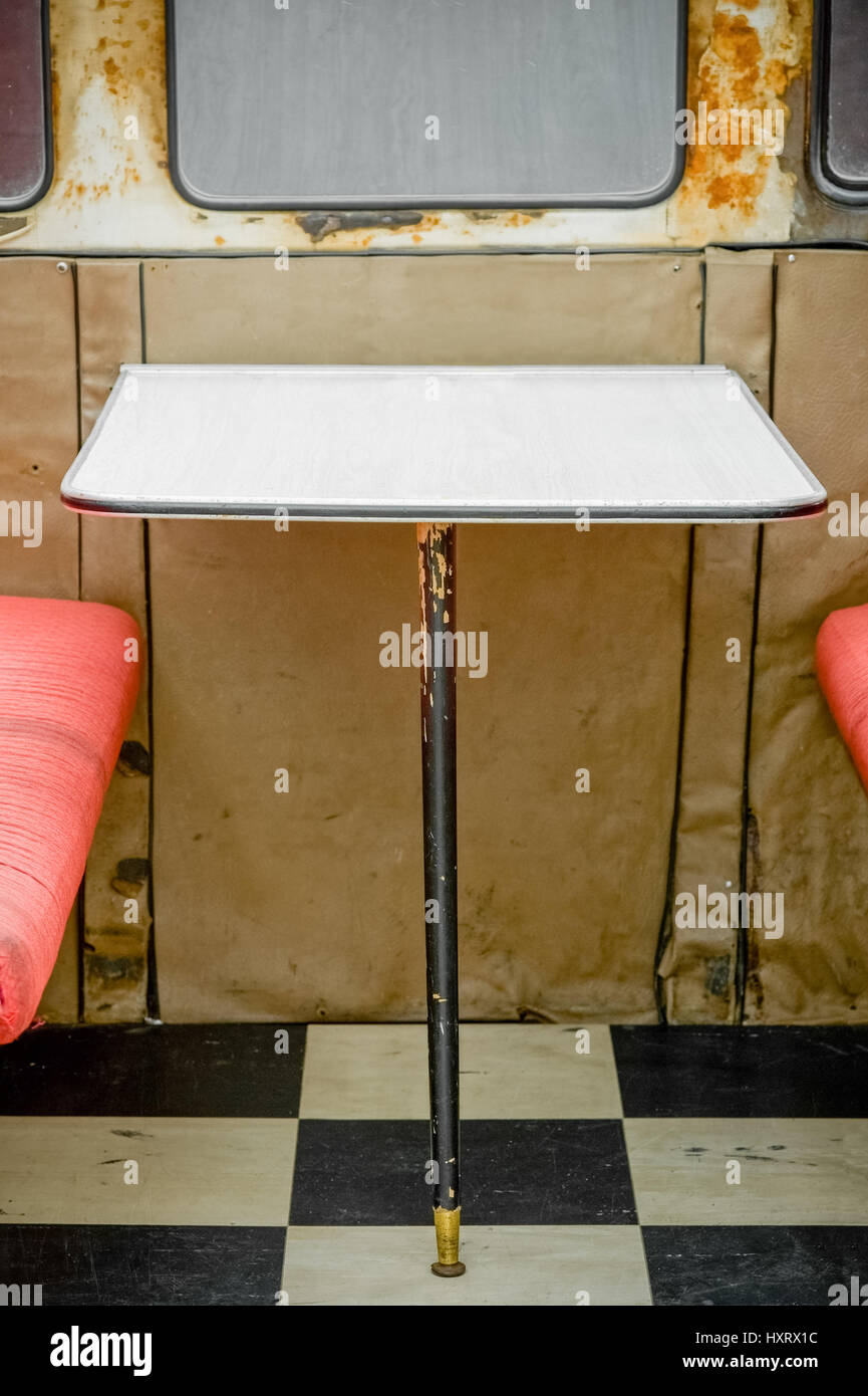 unhygienic diner table with rust around the windows - Stock Image