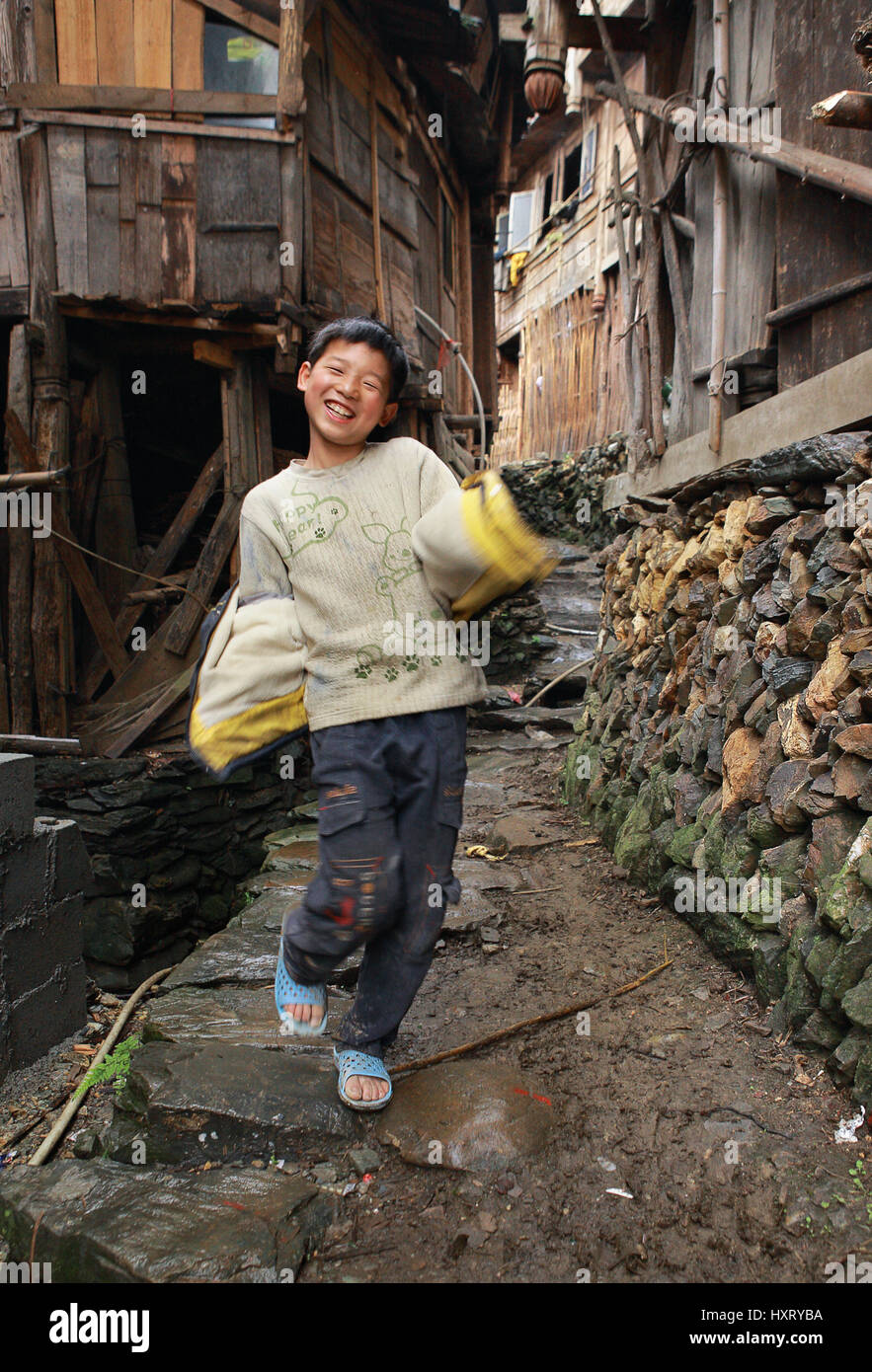 XIAOZHAI VILLAGE, GUANGSI PROVINCE,CHINA - APRIL 5: East Asia, countryside, rural Chinese boy 12 years old, dancing, - Stock Image