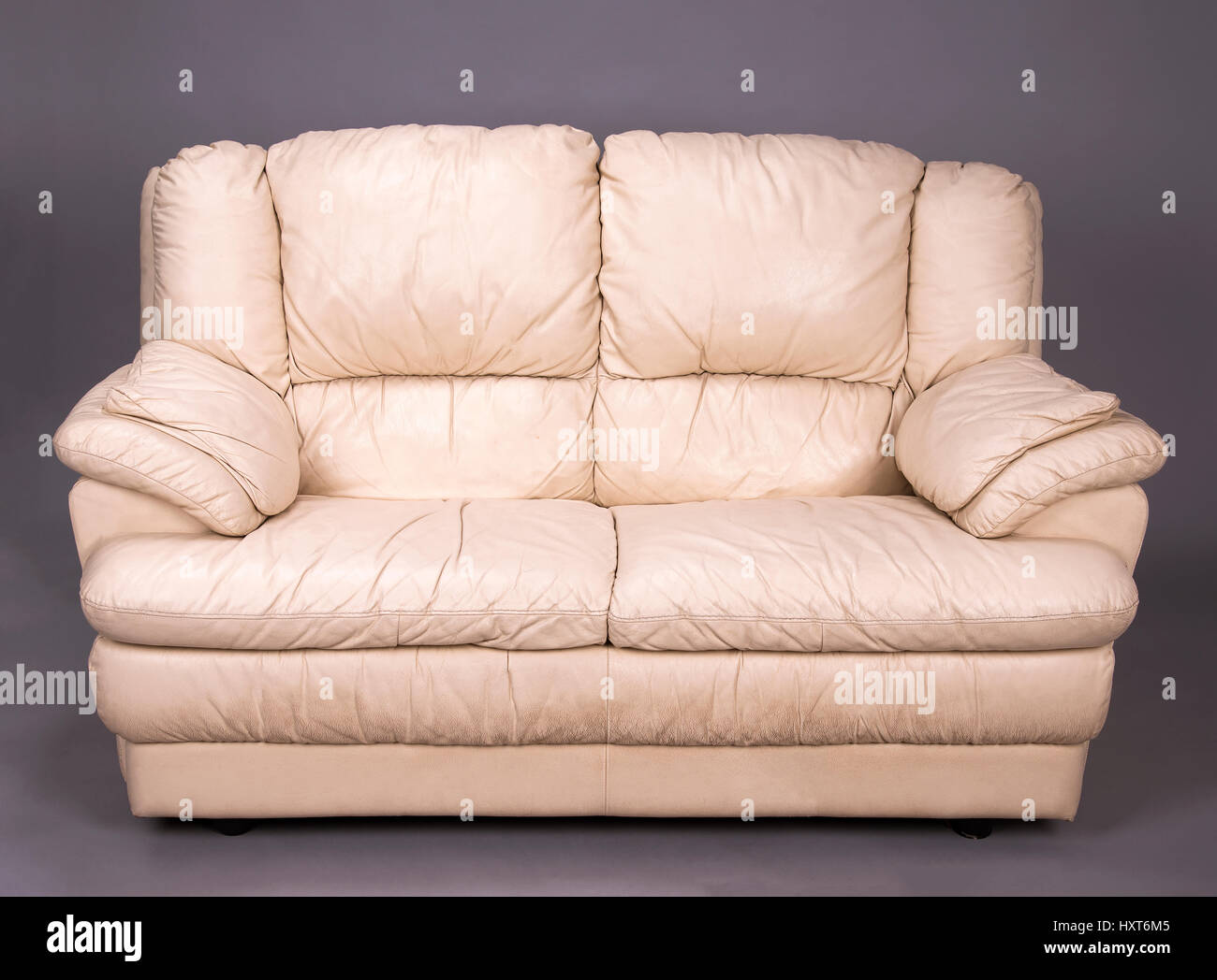 a grubby two seater cream colored leather sofa stock photo rh alamy com cream colored leather sofas for sale cream color leather reclining sofa