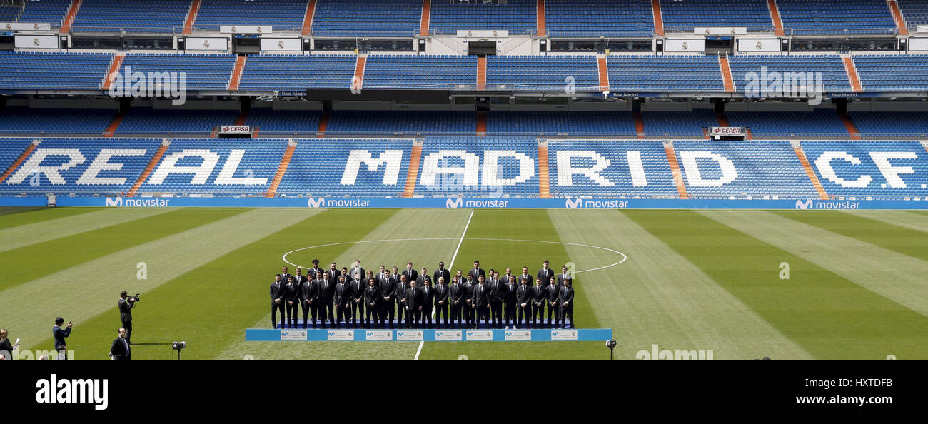 Members from Real Madrid's soccer and basketball teams pose for a family picture during the presentation of - Stock Image
