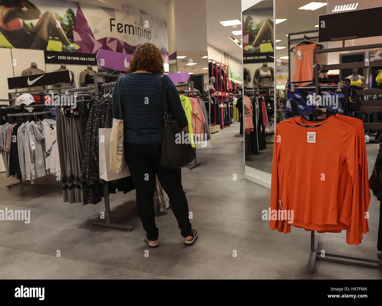 e571172762 A woman shops clothes at a mall in Rio de Janeiro