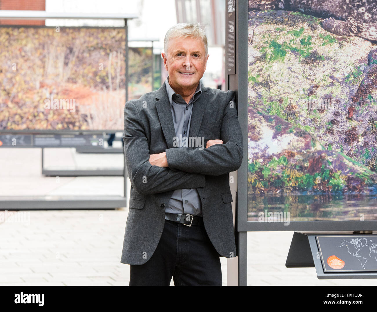 Hamburg, Germany. 30th Mar, 2017. Art Wolfe stands next to one of his works on display as part of the city of Hamburg's - Stock Image
