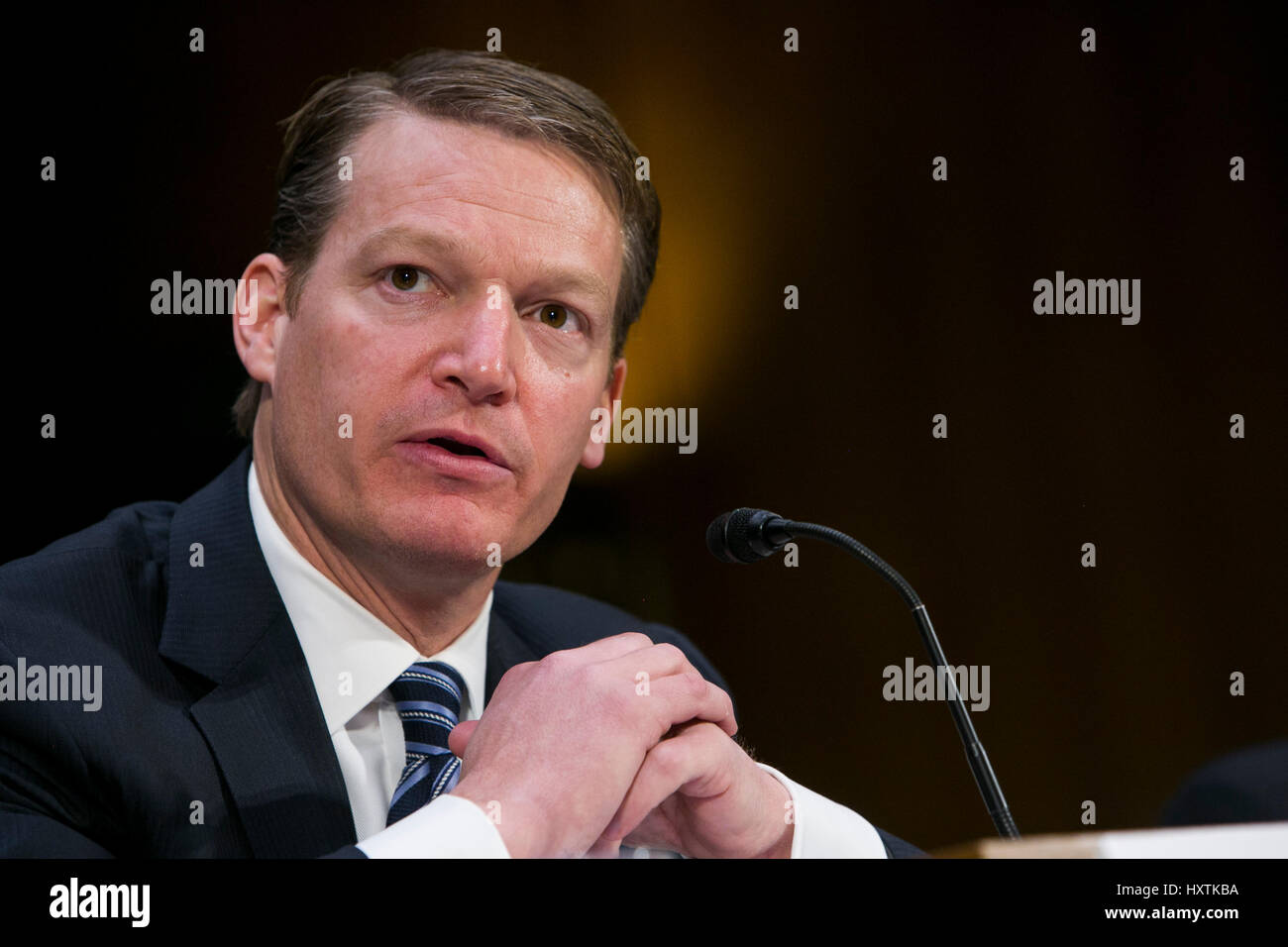 Washington DC, USA. 31st March 2017. Kevin Mandia, CEO of FireEye, testifies during a Senate Select Committee on - Stock Image