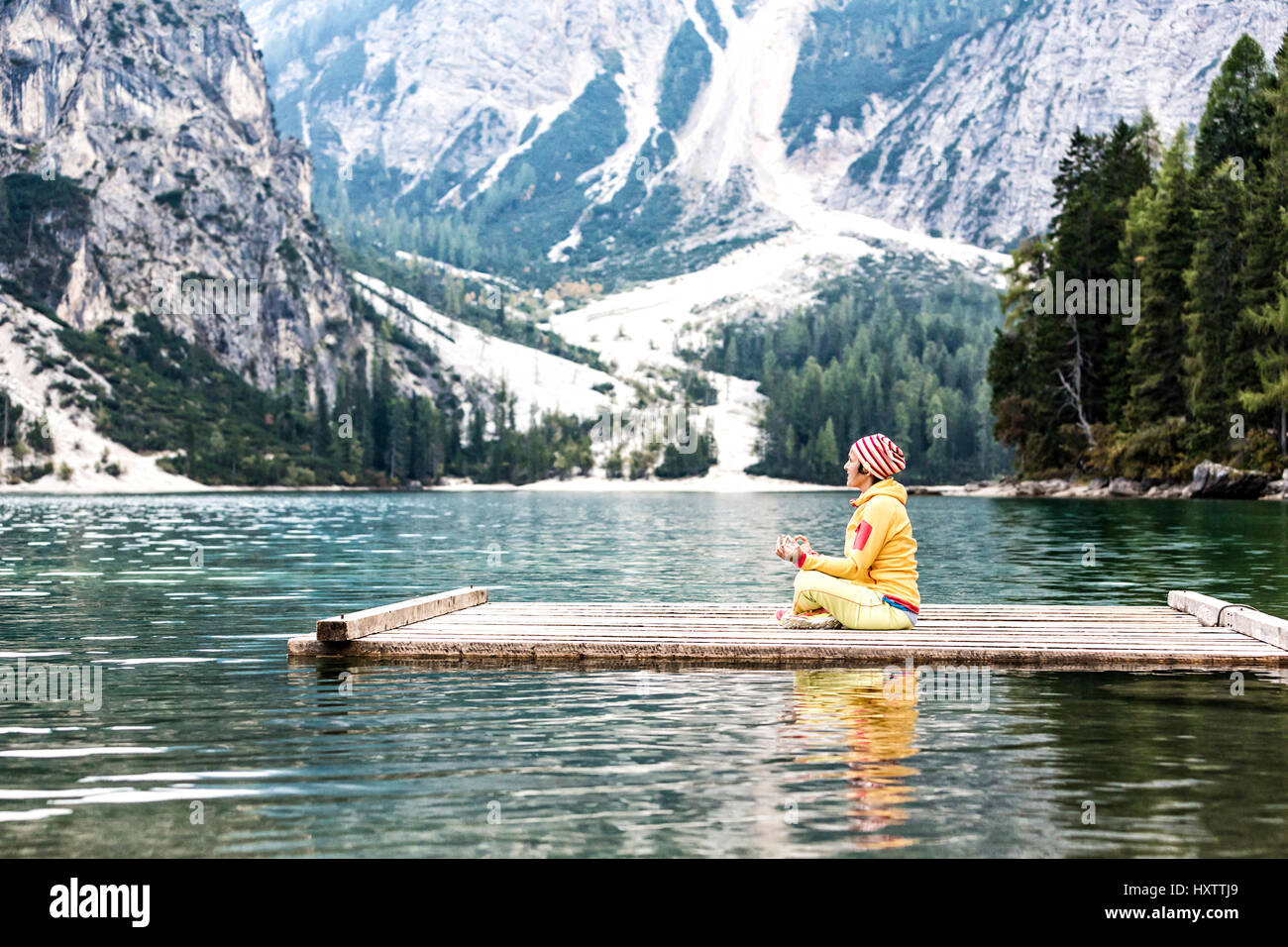 Yoga at the lake, lago di braies, Dolomites - Stock Image