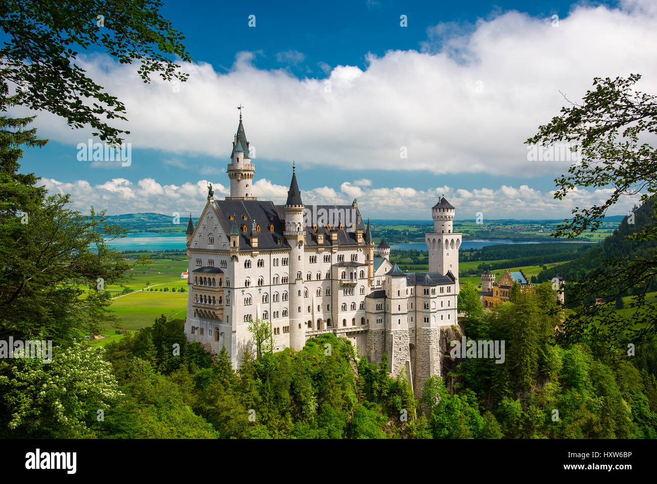 Beautiful view of world-famous Neuschwanstein Castle, the 19th century Romanesque Revival palace built for King - Stock Image