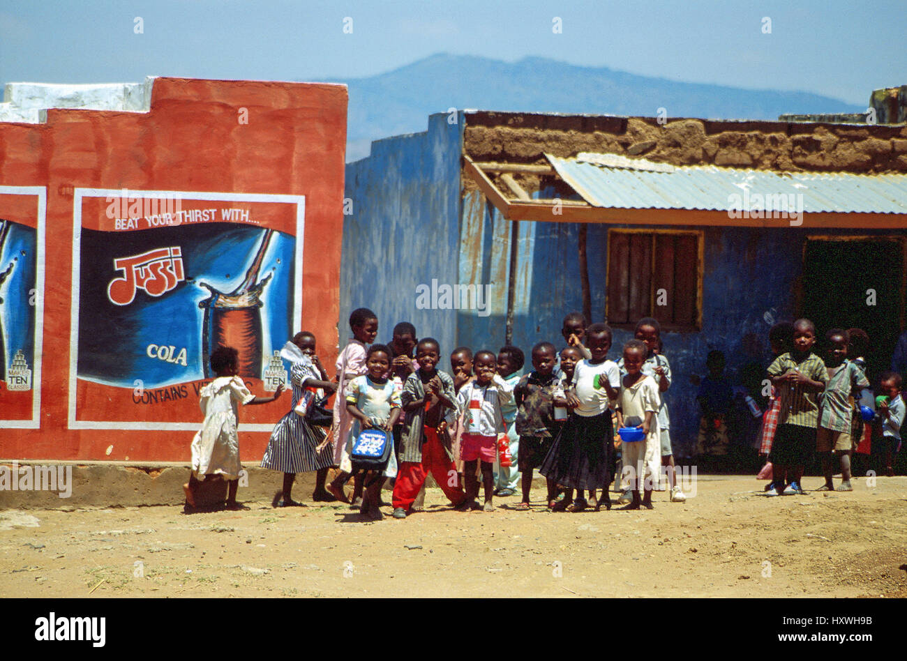 Children gathered in a roadside village, Malawi, Central Africa - Stock Image