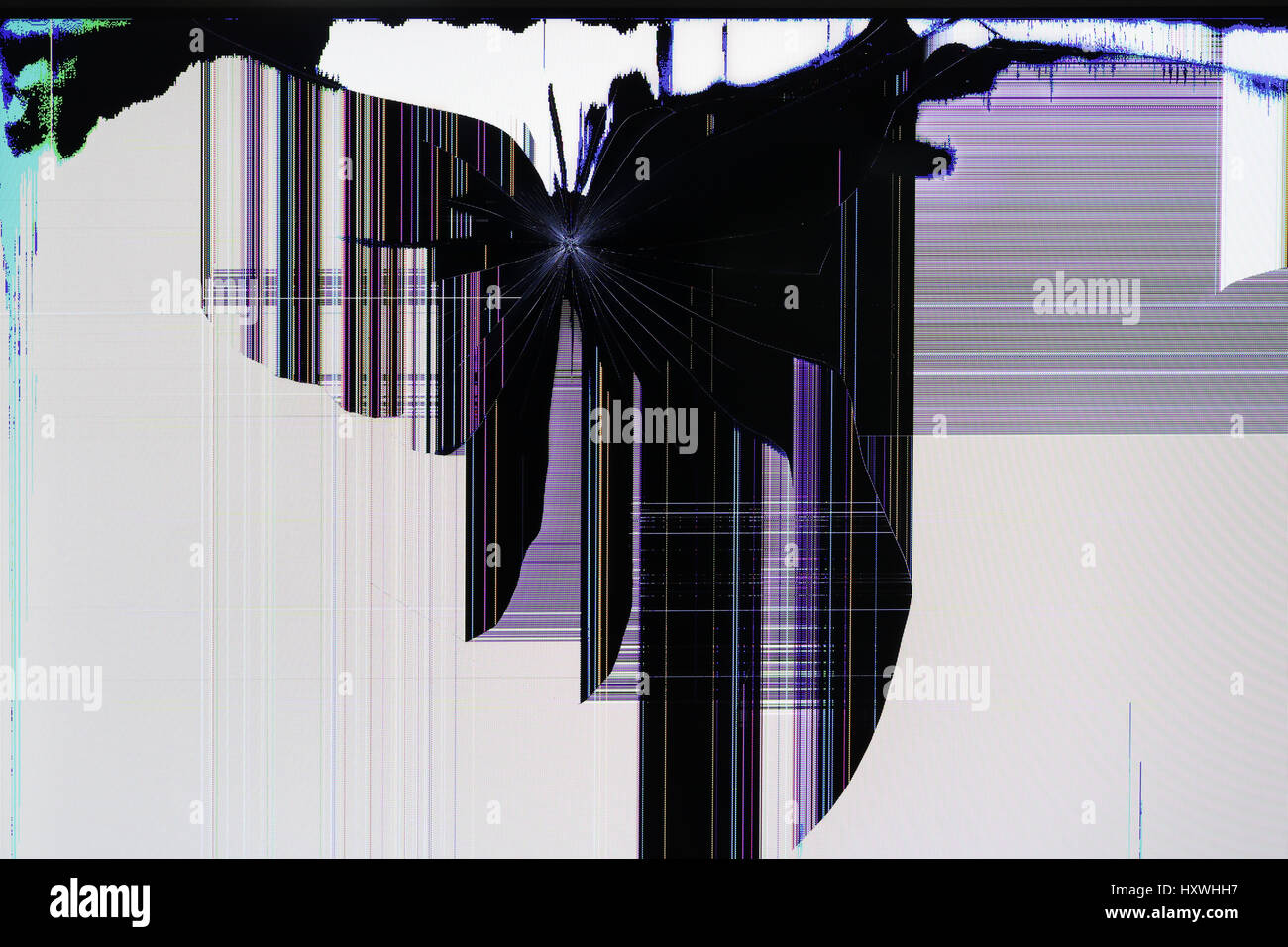 The LCD screen of the tv setis broken by shots from the traumatic gun. Color strips and pixels the abstract background - Stock Image