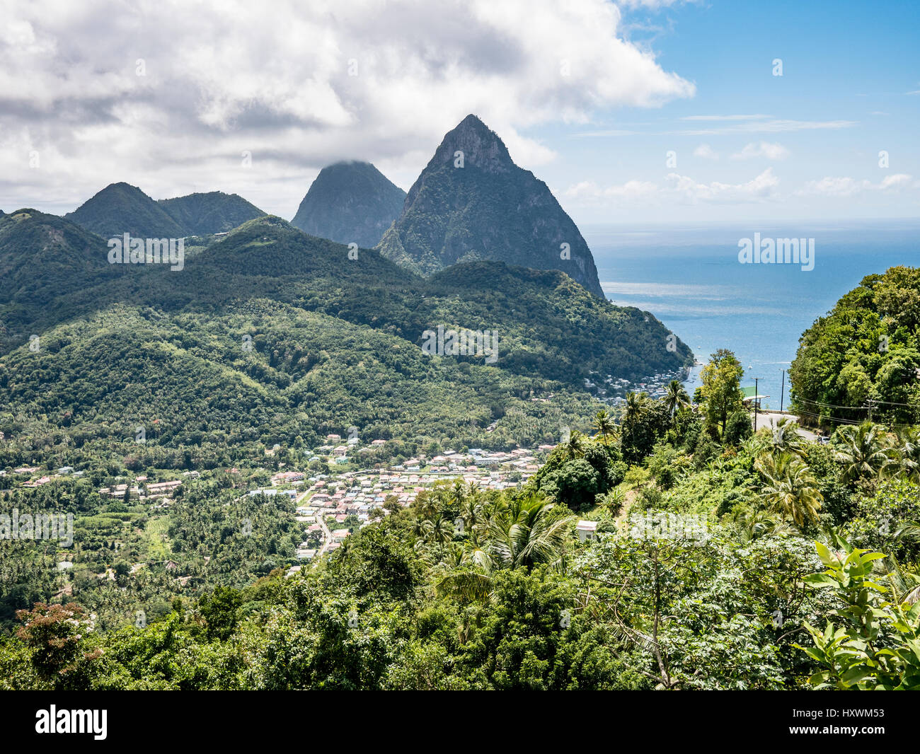 View over Caribbean Island of St. Lucia and Town of Soufrieres to Volcanic Spines the Pitons - Stock Image