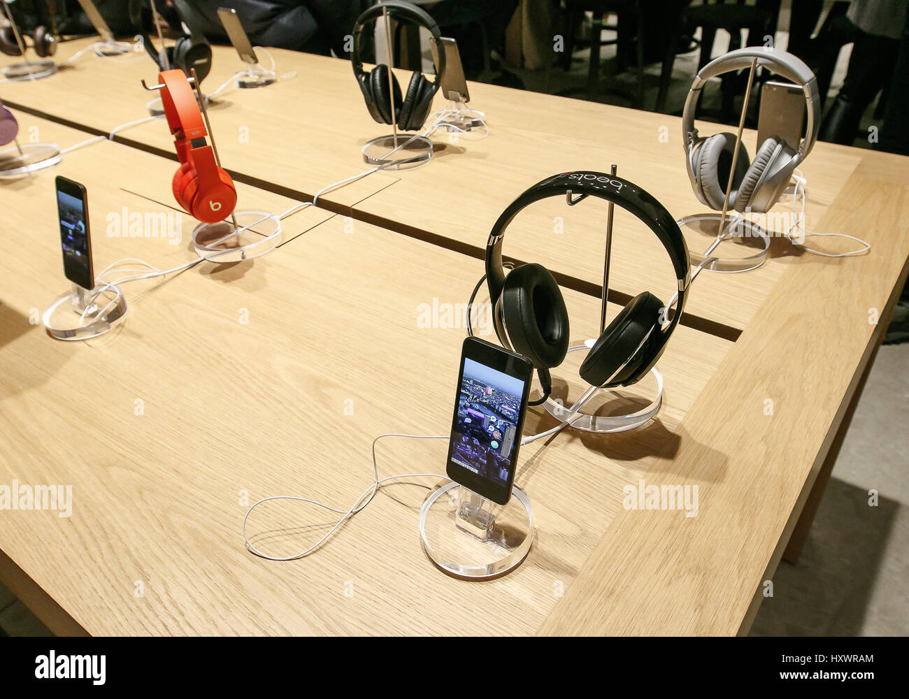 The new iPod Touch and Beats headphones are set on display in an Apple store . 40def2572