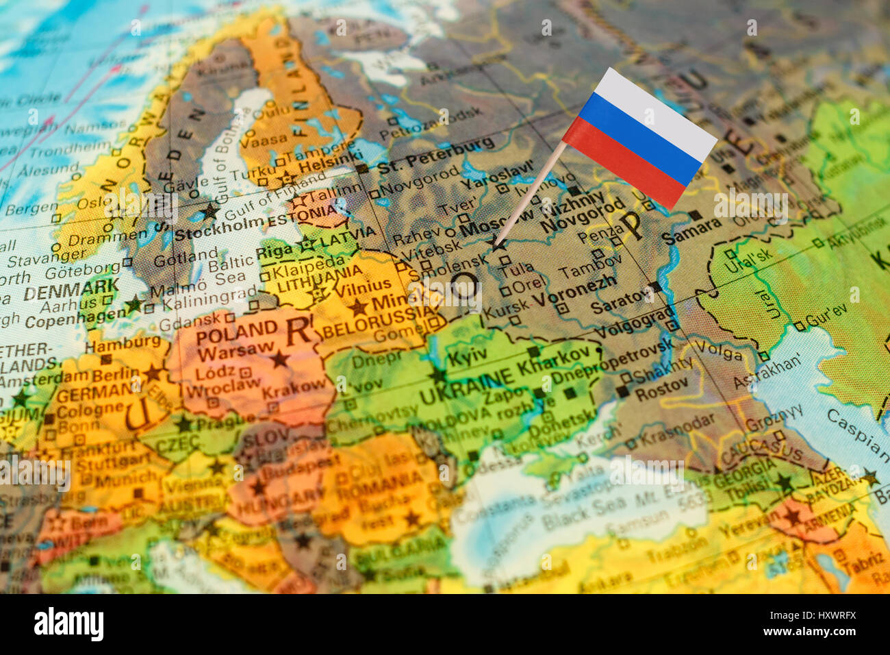 Map Of Russia In Russian.Map With Miniature Flag Of Russia Selective Focus On Russian Flag