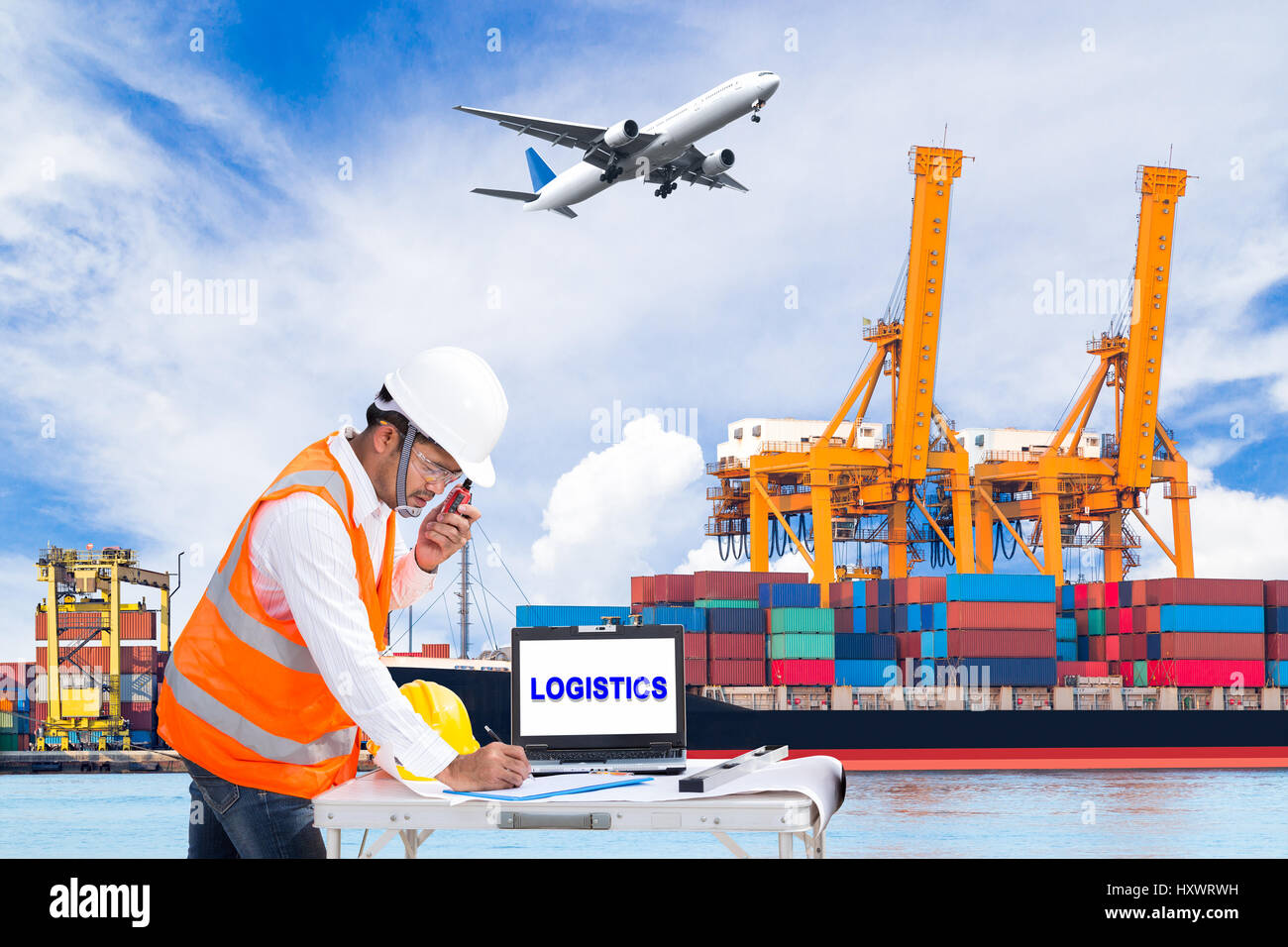 Engineer dockers talking on the walkie-talkie for controlling loading container and recording data in an industrial - Stock Image