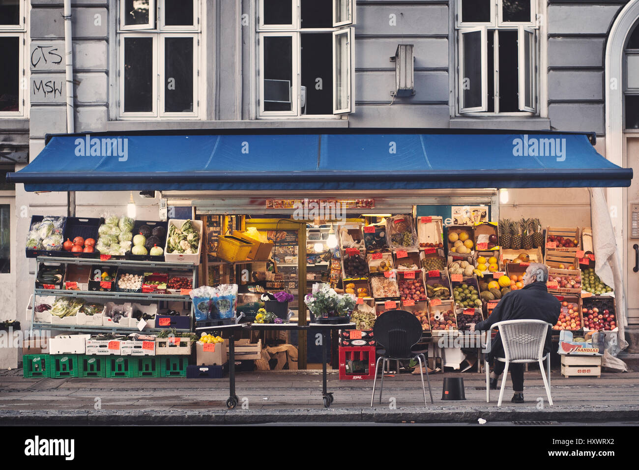 A greengrocer in the Norrebro district in Copenhagen, Denmark. The neighborhood is known for his multicultural flair - Stock Image