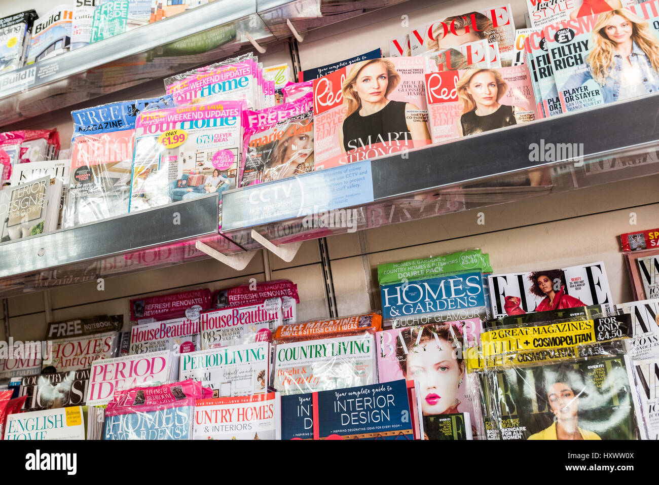 Magazines on stand in newsagents - Stock Image