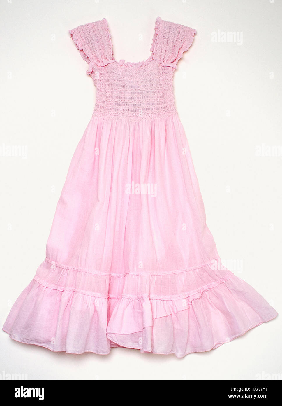 A little girls pink dress. - Stock Image