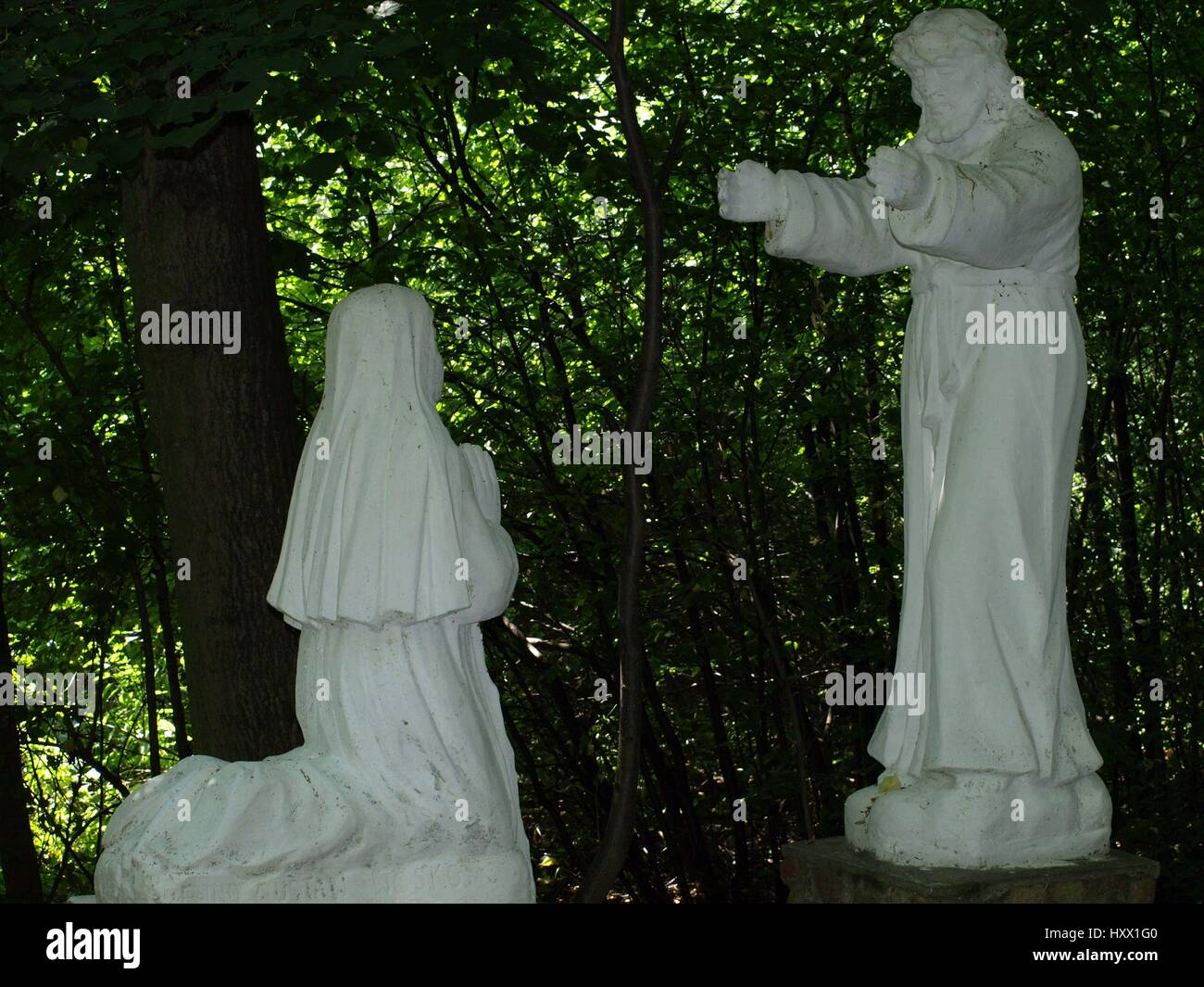 Stoned statues of saints in the shrine of the Holy Otylia in Urzedow, Poland - Stock Image