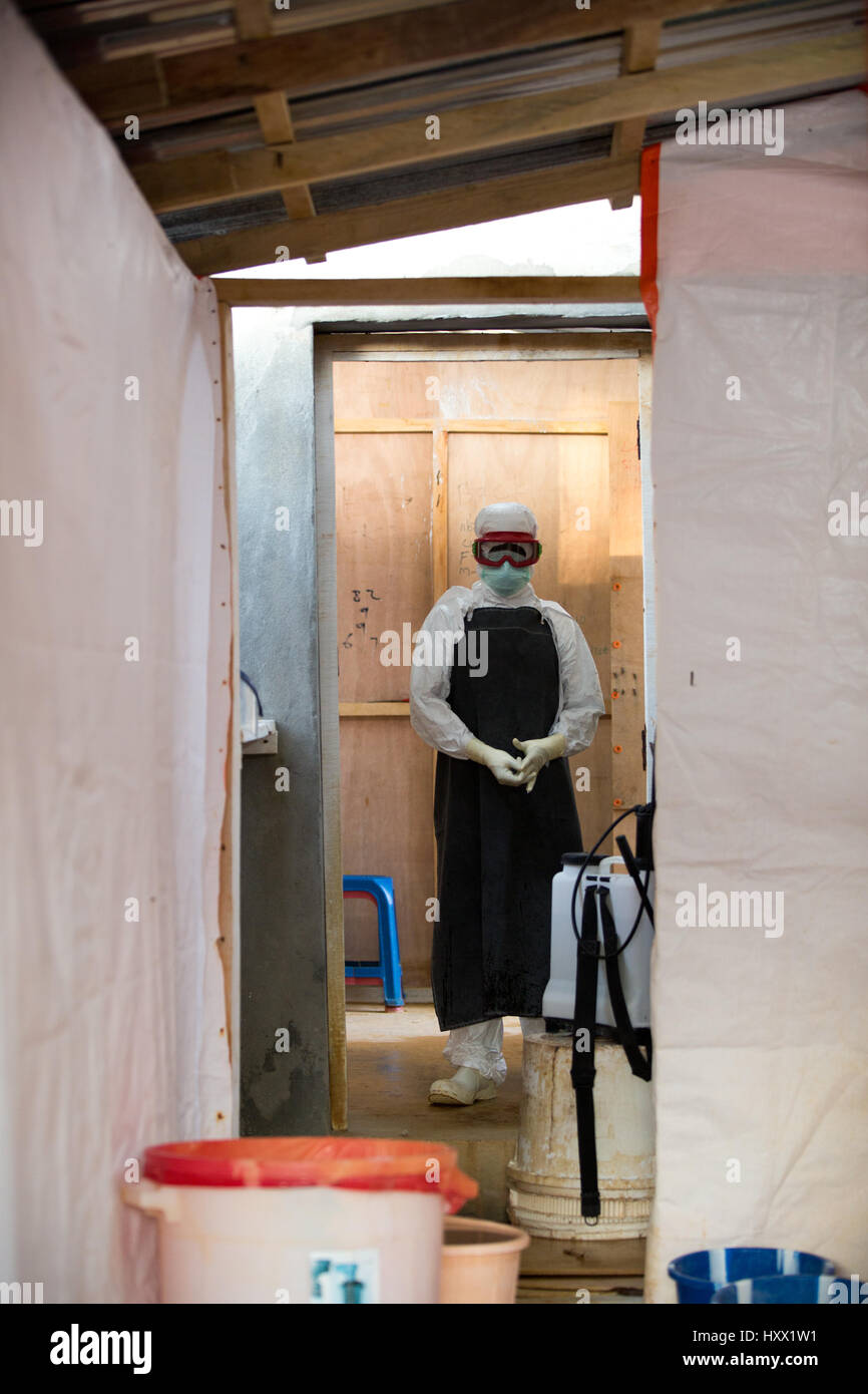 The Doctors, Nurses and Hygienists all leave the Red Zone, the contaminated zone via the sprayers. They have to - Stock Image