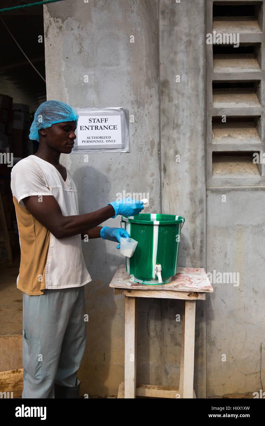 Portrait of a Chemist mixing the chlorine at ELWA 2 Ebola treatment unit - Stock Image