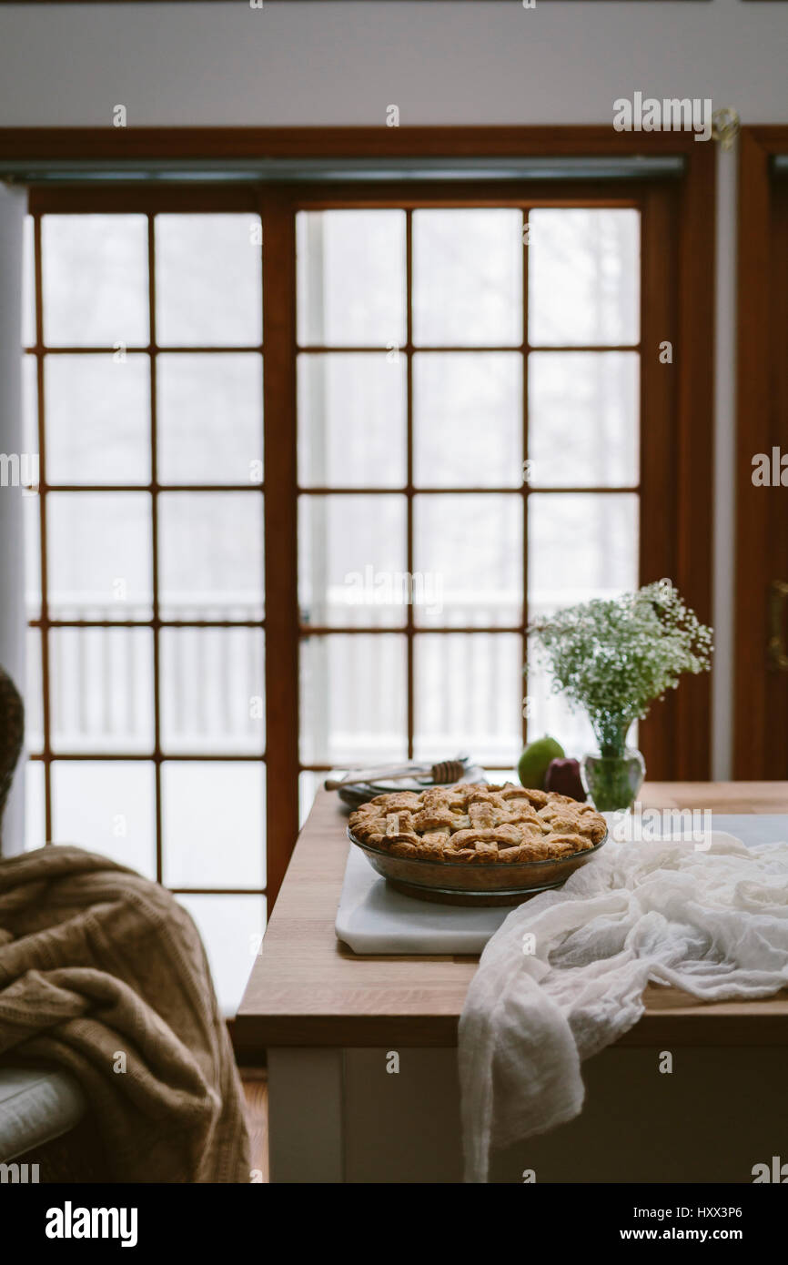 An apple pie photographed on a table in a home - Stock Image