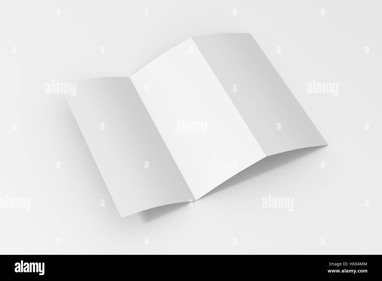 blank trifold paper brochure on white background with soft shadows and highlights stock image